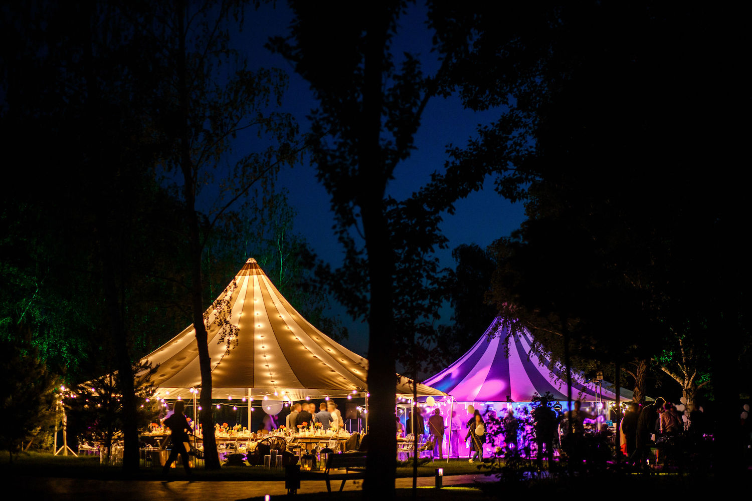 Colorful wedding tents at night. Wedding day